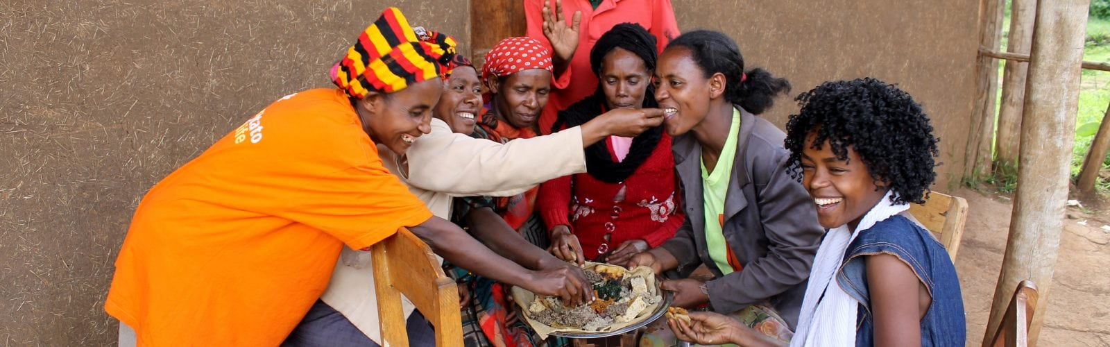 People laughing and eating food together