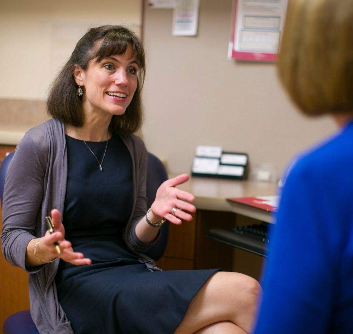 Dr. Schwarze talking to patient