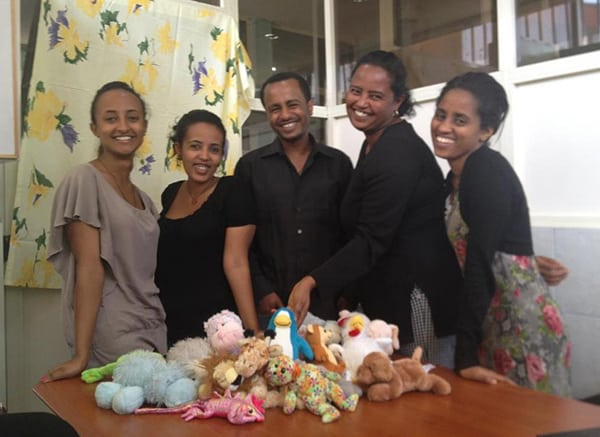 Five Women with stuffed animal toys